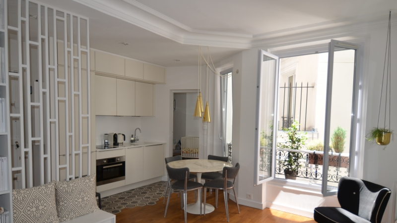 Réunion de deux appartements à Paris photo 1